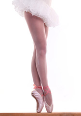 Lower half waist down image of ballet dancer on pointe