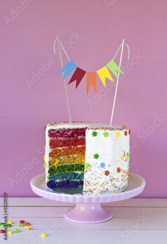Rainbow cake with flags for kids party