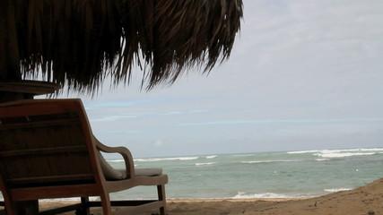 Chair blows in wind at beach