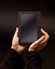 hands holding tablet pc