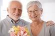 Portrait of happy elderly couple