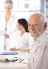 Mature man on health control smiling