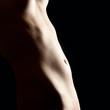 Weibliche Kurven einer schönen nackten Frau