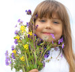 Little girl with wildflower