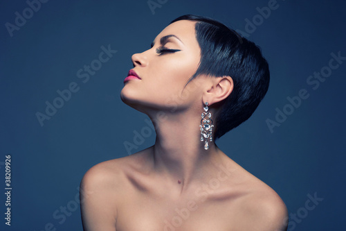 Sensual lady with diamond earring