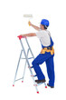 Handyman or worker painting with roller brush