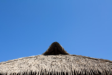 Thatched roof and blue sky in Thailand.