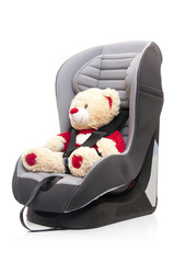 teddy bear sitting on child's car seat