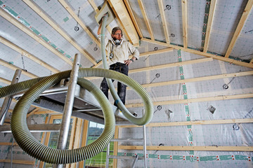 installing dry cellulose fiber blown-in insulation