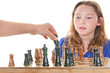 Girl watching player make chess move