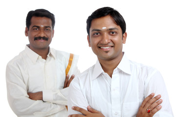 Traditional Indian young people posing to the camera.