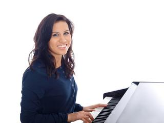 smiling teenage girl playing piano