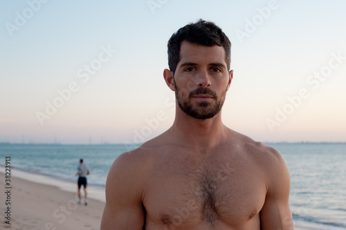 Muscular man on the beach.