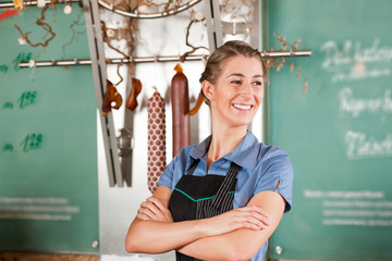 Female Butcher Smiling with Confidence