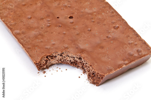 nibbled chocolate bar on white background