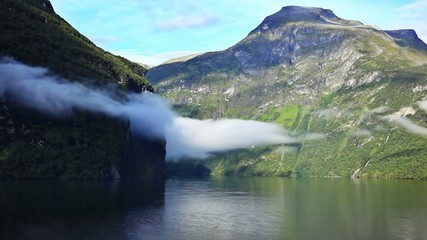 Clouds over Geiranger fjord. Fast motion effect.