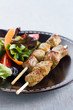 Beef skewer with salad