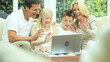 Young Caucasian Family Using Online Webchat