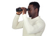 Attractive african man looking through binoculars