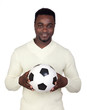 Attractive african man with a soccer ball
