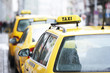 yellow taxi cab cars