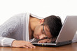 Tired guy sleeping on laptop