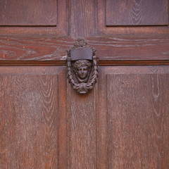 A cast metal door knocker at Castle Combe, Wiltshire