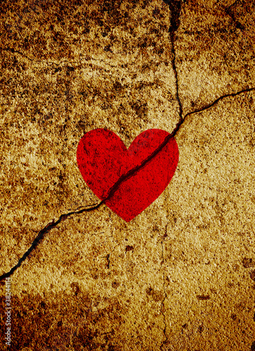 Red valentine heart on cracked grunge background