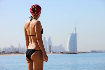Rear view of young woman on Jumeira beach, Dubai, UAE