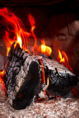 Fire on fire wood in a fireplace, a grill