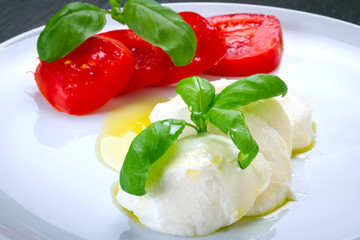 Caprese - italian mozzarella cheese with tomatoes and basil