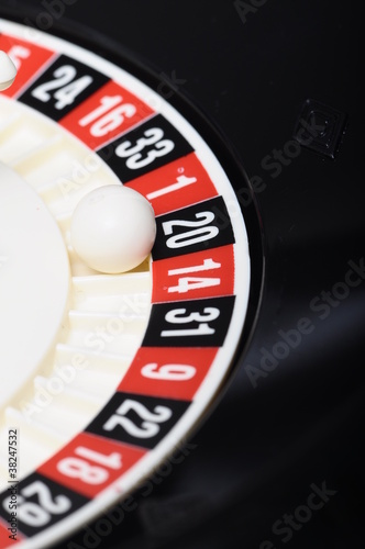 Close view of casino roulette and ball on number