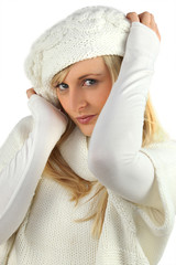 pretty coquettish young blonde wearing white cardigan and bonnet