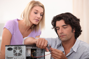 Man cutting a wire