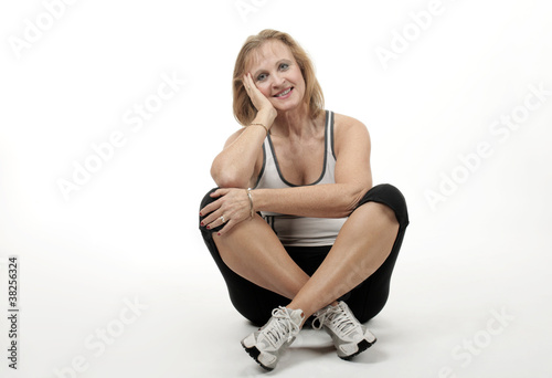 An elderly woman relaxes after exercise