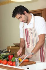 Young man preparing vegetables