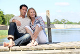 Couple sat on jetty