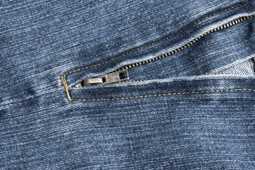 Zipper on the blue denim