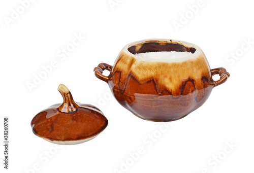 Ceramic pot with salt, isolated on white background