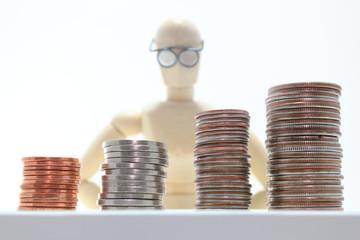 Wooden character watching money