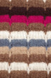 Vertical closeup of multicolored woolen texture