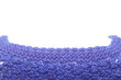 Closeup of dark blue woolen sweater neck on white