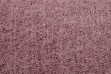 Closeup of light brown shag woolen texture