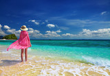 Woman in pink pareo and hat at the beach, Andaman Sea, Thailand poster
