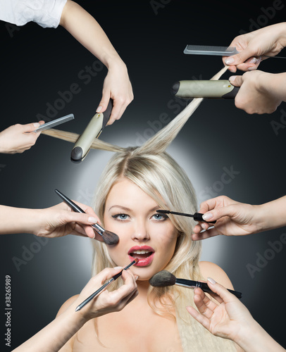 Portrait beautiful white hair girl with makeup brushes near attr