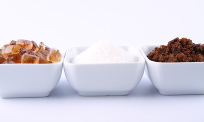 Sugar: brown, white and brown rock candy in bowls