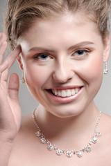 Pretty woman with diamond necklace