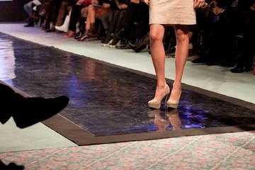 model posing on catwalk