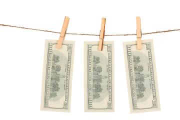 Three one hundred dollar bills is hanging
