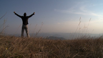 Man on the top of a hill